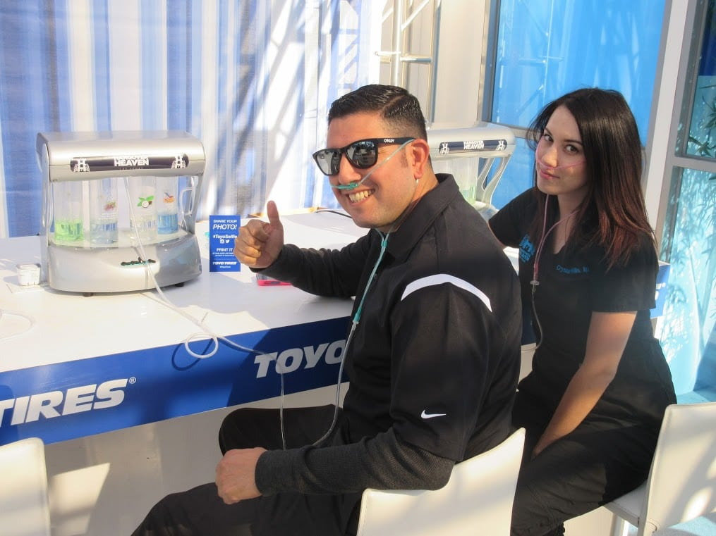Two people partake in an oxygen bar provided by Hangover Heaven