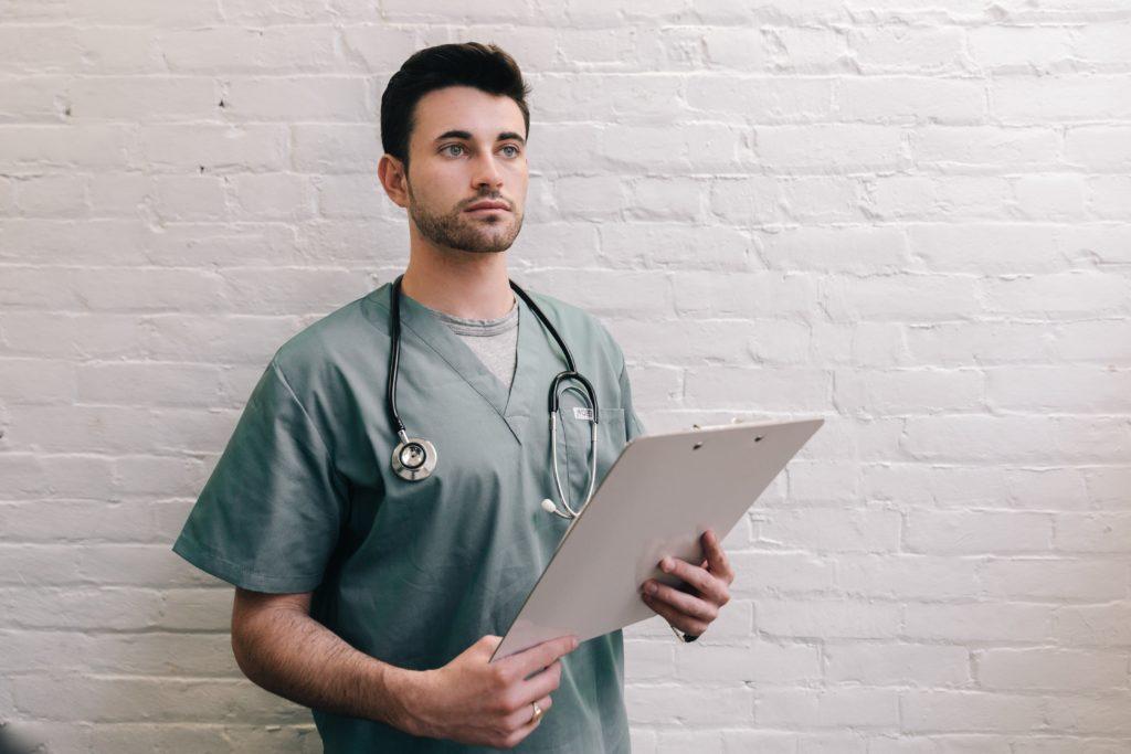 male doctor holding clipboard photo